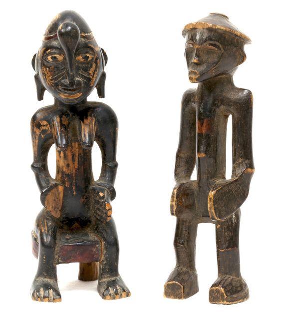 two Senufo carved wooded figures, a man and woman