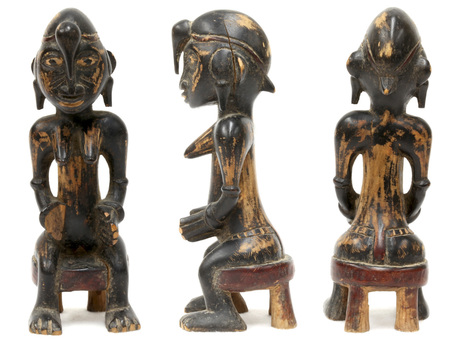 Carved wooden Sunufo figurine of woman seated on stool