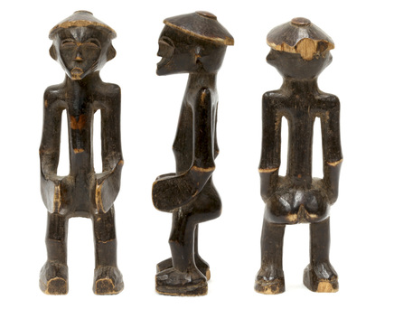 Carved wooded Senufo figurine of man with conical hat standing